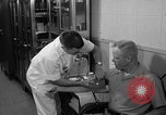 Image of preflight physical checkup United States USA, 1962, second 43 stock footage video 65675051196