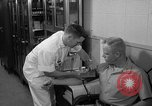 Image of preflight physical checkup United States USA, 1962, second 44 stock footage video 65675051196