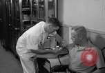 Image of preflight physical checkup United States USA, 1962, second 46 stock footage video 65675051196
