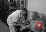 Image of preflight physical checkup United States USA, 1962, second 47 stock footage video 65675051196