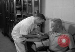 Image of preflight physical checkup United States USA, 1962, second 48 stock footage video 65675051196
