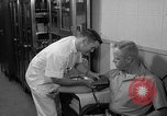 Image of preflight physical checkup United States USA, 1962, second 49 stock footage video 65675051196