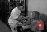 Image of preflight physical checkup United States USA, 1962, second 52 stock footage video 65675051196