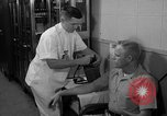 Image of preflight physical checkup United States USA, 1962, second 54 stock footage video 65675051196