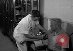 Image of preflight physical checkup United States USA, 1962, second 55 stock footage video 65675051196