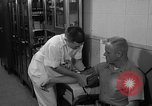 Image of preflight physical checkup United States USA, 1962, second 56 stock footage video 65675051196