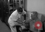 Image of preflight physical checkup United States USA, 1962, second 57 stock footage video 65675051196