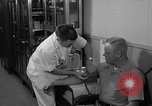Image of preflight physical checkup United States USA, 1962, second 58 stock footage video 65675051196