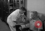 Image of preflight physical checkup United States USA, 1962, second 59 stock footage video 65675051196
