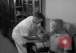 Image of preflight physical checkup United States USA, 1962, second 60 stock footage video 65675051196