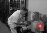 Image of preflight physical checkup United States USA, 1962, second 62 stock footage video 65675051196