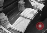 Image of Newspaper headlines tell of Allied invasion New York City USA, 1944, second 5 stock footage video 65675051457