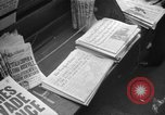 Image of Newspaper headlines tell of Allied invasion New York City USA, 1944, second 6 stock footage video 65675051457