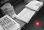 Image of Newspaper headlines tell of Allied invasion New York City USA, 1944, second 8 stock footage video 65675051457