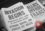 Image of Newspaper headlines tell of Allied invasion New York City USA, 1944, second 9 stock footage video 65675051457