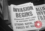 Image of Newspaper headlines tell of Allied invasion New York City USA, 1944, second 10 stock footage video 65675051457