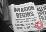 Image of Newspaper headlines tell of Allied invasion New York City USA, 1944, second 11 stock footage video 65675051457