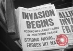 Image of Newspaper headlines tell of Allied invasion New York City USA, 1944, second 12 stock footage video 65675051457