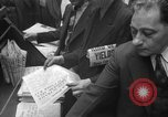 Image of Newspaper headlines tell of Allied invasion New York City USA, 1944, second 16 stock footage video 65675051457