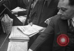 Image of Newspaper headlines tell of Allied invasion New York City USA, 1944, second 19 stock footage video 65675051457