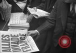 Image of Newspaper headlines tell of Allied invasion New York City USA, 1944, second 22 stock footage video 65675051457