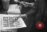 Image of Newspaper headlines tell of Allied invasion New York City USA, 1944, second 23 stock footage video 65675051457