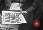 Image of Newspaper headlines tell of Allied invasion New York City USA, 1944, second 24 stock footage video 65675051457