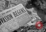 Image of Newspapers carry stories about Allied Invasion of France New York City USA, 1944, second 16 stock footage video 65675051458