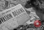 Image of Newspapers carry stories about Allied Invasion of France New York City USA, 1944, second 18 stock footage video 65675051458