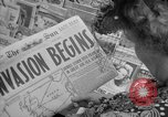 Image of Newspapers carry stories about Allied Invasion of France New York City USA, 1944, second 19 stock footage video 65675051458