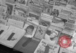 Image of Newspapers carry stories about Allied Invasion of France New York City USA, 1944, second 23 stock footage video 65675051458