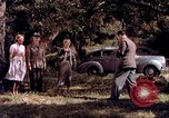 Image of People visiting a forest in their 1939 Ford car United States USA, 1939, second 24 stock footage video 65675051552