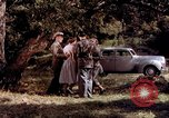 Image of People visiting a forest in their 1939 Ford car United States USA, 1939, second 27 stock footage video 65675051552