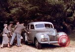 Image of People visiting a forest in their 1939 Ford car United States USA, 1939, second 32 stock footage video 65675051552