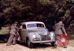 Image of People visiting a forest in their 1939 Ford car United States USA, 1939, second 36 stock footage video 65675051552