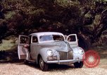Image of People visiting a forest in their 1939 Ford car United States USA, 1939, second 39 stock footage video 65675051552