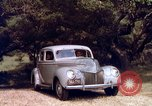 Image of People visiting a forest in their 1939 Ford car United States USA, 1939, second 42 stock footage video 65675051552