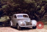 Image of People visiting a forest in their 1939 Ford car United States USA, 1939, second 44 stock footage video 65675051552