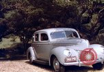 Image of People visiting a forest in their 1939 Ford car United States USA, 1939, second 48 stock footage video 65675051552
