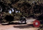 Image of People visiting a forest in their 1939 Ford car United States USA, 1939, second 54 stock footage video 65675051552
