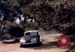 Image of People visiting a forest in their 1939 Ford car United States USA, 1939, second 55 stock footage video 65675051552