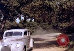Image of People visiting a forest in their 1939 Ford car United States USA, 1939, second 56 stock footage video 65675051552