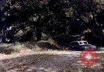 Image of People visiting a forest in their 1939 Ford car United States USA, 1939, second 58 stock footage video 65675051552
