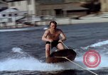 Image of motorboat pulling man and woman balanced on aquaplane United States USA, 1939, second 14 stock footage video 65675051556