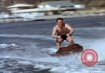 Image of motorboat pulling man and woman balanced on aquaplane United States USA, 1939, second 17 stock footage video 65675051556