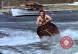 Image of motorboat pulling man and woman balanced on aquaplane United States USA, 1939, second 18 stock footage video 65675051556