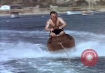Image of motorboat pulling man and woman balanced on aquaplane United States USA, 1939, second 19 stock footage video 65675051556