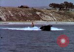 Image of motorboat pulling man and woman balanced on aquaplane United States USA, 1939, second 21 stock footage video 65675051556