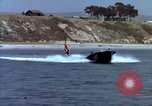 Image of motorboat pulling man and woman balanced on aquaplane United States USA, 1939, second 22 stock footage video 65675051556