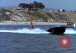 Image of motorboat pulling man and woman balanced on aquaplane United States USA, 1939, second 24 stock footage video 65675051556